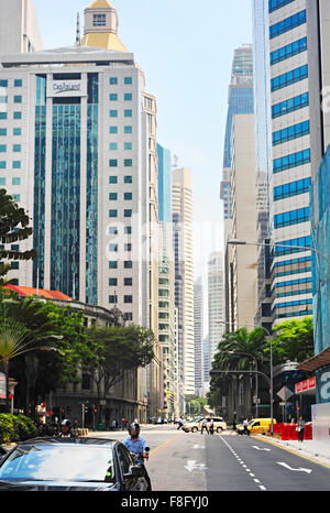 Traffic on a road at Singapore Downtown Core. - Stock Photo