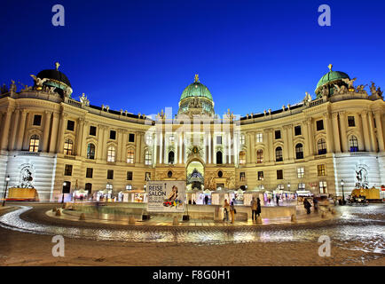 View of Hofburg, the imperial palace of the Habsburgs, from Michaelerplatz Vienna, Austria - Stock Photo