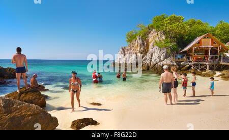 Thailand - Khai Island, Phang Nga Bay, tourists on the beach - Stock Photo