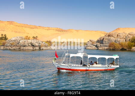 Egypt - cruise on the Nile, small cruise ship sailing to Aswan, protected area of the First Cataract of Nile - Stock Photo