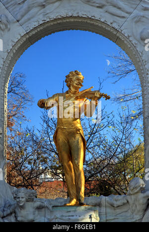 The 'golden' statue of Johann Strauss in Stadtpark  ('city park') Vienna, Austria. - Stock Photo