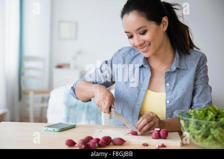 Chinese woman preparing salad - Stock Photo