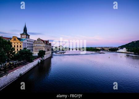 Blue sky over Prague waterfront, Czech Republic - Stock Photo