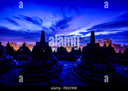 Silhouette of monuments in Borobudur, Jawa Tengah, Indonesia - Stock Photo