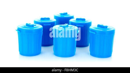 Six Blue Plastic Trash Cans on a White Background - Stock Photo
