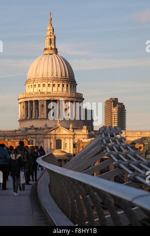 The Millennium bridge leading to St Pauls cathedral at London in December - Stock Photo