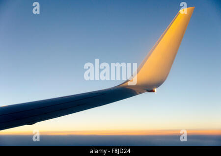 Aircraft Wing over Tasman Sea, between Australia and New Zealand in late afternoon - Stock Photo