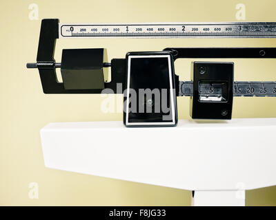 Physician Beam Scale - Medical professional sliding balance weight scale at a physician's office - Stock Photo