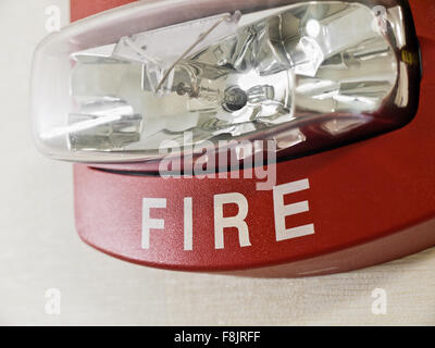 red fire alarm smoke detector with strobe light mounted on a wall as. Black Bedroom Furniture Sets. Home Design Ideas