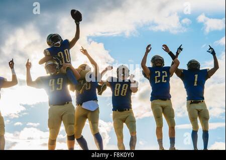 Group of young american football players, celebrating - Stock Photo