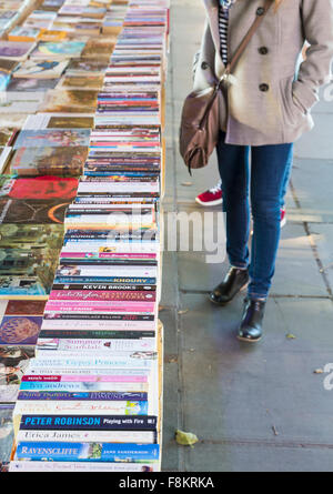 Second hand book stall under Waterloo Bridge on South Bank, London, England - Stock Photo