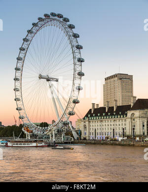 London Eye or Millennium Wheel on South Bank of River Thames in London England, UK - Stock Photo