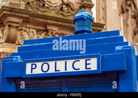 An old style Police Phone Box painted blue in Glasgow, Scotland, UK - Stock Photo
