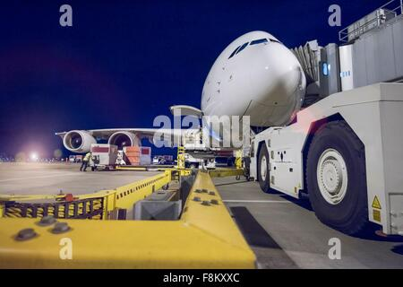 Night over A380 aircraft on stand at airport - Stock Photo
