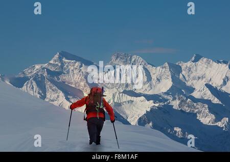 Rear view of climber moving up through deep snow, Swiss Alps, Canton Wallis, Switzerland - Stock Photo