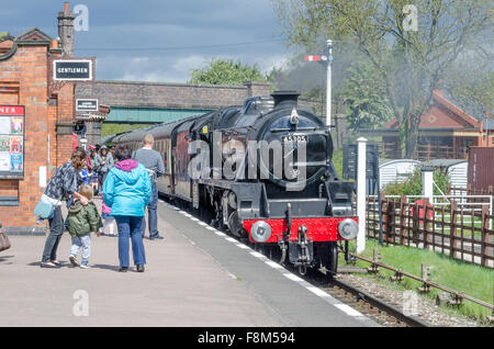 People waiting on platform and steam train arriving, Quorn and Woodhouse Station, Loughborough, Leicestershire, - Stock Photo