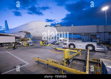 A380 aircraft on stand at airport - Stock Photo