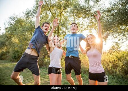 Portrait of group of friends in rural environment, fooling around, smiling - Stock Photo
