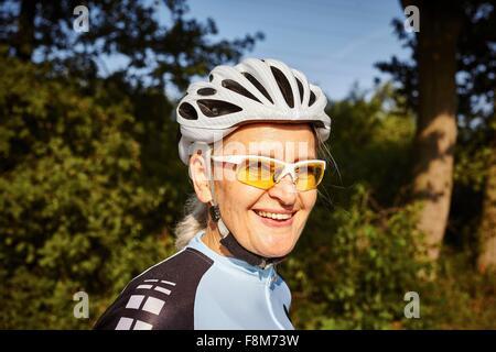 Portrait of mature cyclist - Stock Photo