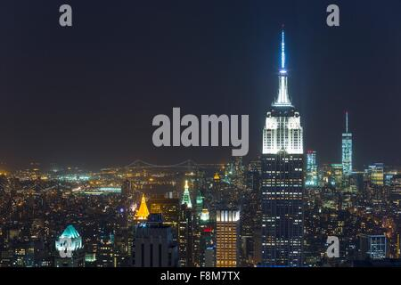 High angle cityscape of midtown Manhattan and Empire State building at night, New York, USA - Stock Photo