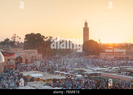 Djemaa el Fnaa and Koutoubia mosque at dusk, Marrakech, Morocco - Stock Photo