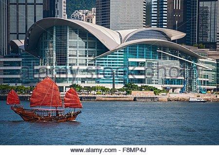Traditional Chinese junk sailing at Victoria harbour in Hong Kong, China - Stock Photo
