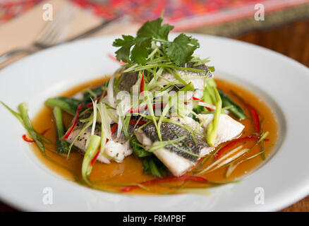 Singapore cuisine served in a restaurant. Fish. - Stock Photo