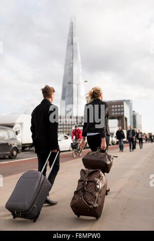 Businessman and businesswoman on business trip, London, UK - Stock Photo