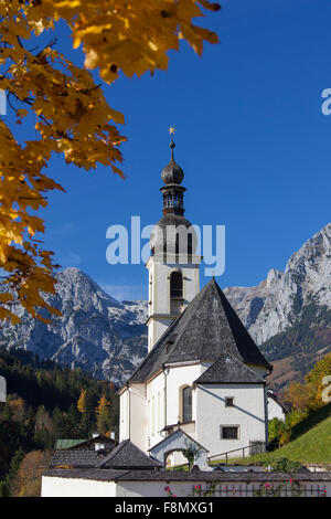 Church of St. Sebastian, with the Reiter Alpe in background in autumn at Ramsau, Berchtesgaden, Bavaria, Germany - Stock Photo