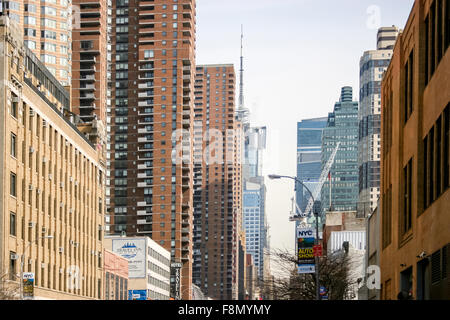 Office and residential buildings viewed from West 42nd street in Midtown Manhattan - Stock Photo