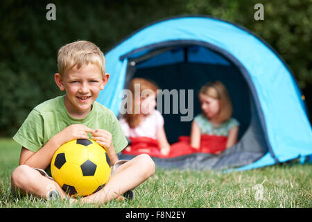 Portrait Of Boy With Friends On Camping Trip - Stock Photo