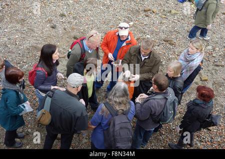 Group of mudlarks on foreshore of River Thames, London - Stock Photo