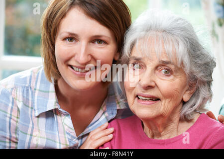 Portrait Of Senior Mother And Adult Daughter - Stock Photo