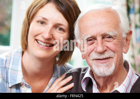 Senior Man With Adult Daughter At Home