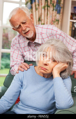 Man Comforting Senior Woman With Depression - Stock Photo