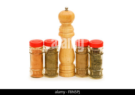 Peppermill and spices isolated on the white - Stock Photo