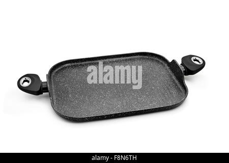 a non-stick iron cast grill pan with two handles on a white background - Stock Photo