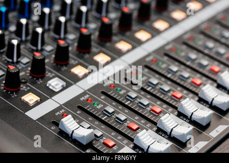 Sound mixing desk. Close up view. Shallow depth of field. - Stock Photo