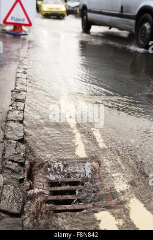 Warning Traffic Sign On Flooded Road With Cars - Stock Photo