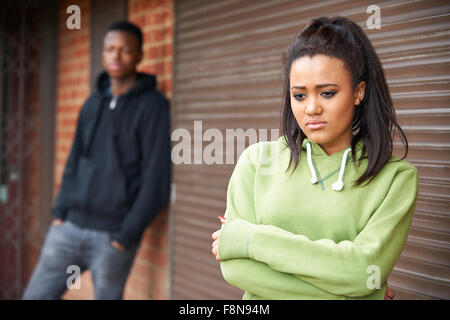 Portrait Of Unhappy Teenage Couple In Urban Setting - Stock Photo
