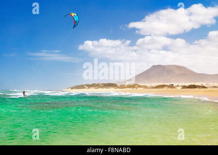 Kitesurfing at the beach near Corralejo, Fuerteventura Island, Canary Islands, Spain, - Stock Photo
