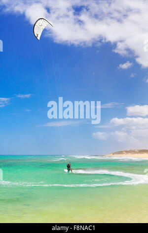 Kitesurfing at the beach on Fuerteventura Island, near Corralejo, Canary Islands, Spain - Stock Photo