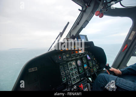 in the cockpit of a helicopter flying from the mainland to Lundy Island, as it appears on the horizon - Stock Photo