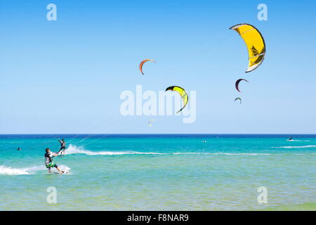 Canary Islands, Fuerteventura Island, kitesurfing at the beach near Costa Calma, Spain - Stock Photo