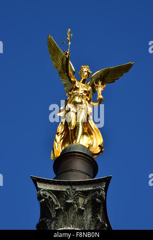 Munich, Germany - gilded statue called PEACE ANGEL (German FRIEDENSENGEL) - Stock Photo