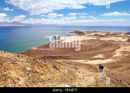 Tourists walking on Lobos Island, Canary Islands, Spain - Stock Photo