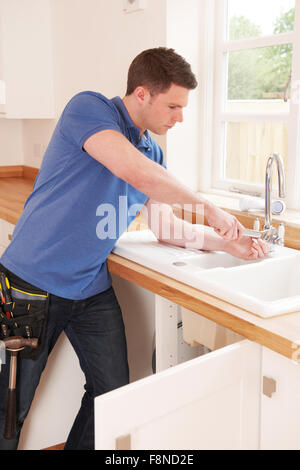 Plumber Mending Tap With Adjustable Wrench - Stock Photo