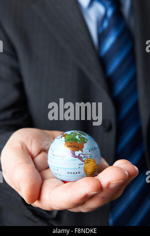 Businessman Holding Globe Showing North America In Hand - Stock Photo