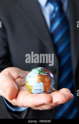 Businessman Holding Globe In Hand - Stock Photo