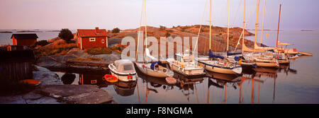 Panoramic scenic of sailboats anchored at dawn in Stora Nassa island group of Stockholm Archipelago - Stock Photo